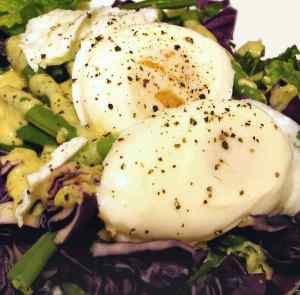 Green beans in a salad with poached eggs