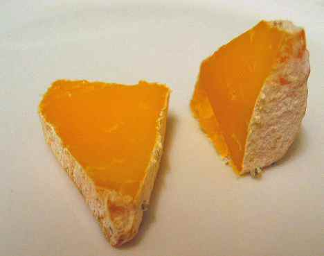 Cheddar after aging with bleu cheese mold