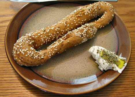 "Simit bread or ""beigele"" with labaneh and herb spread"