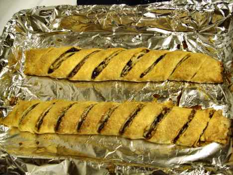 Rugelach rolls slashed, baked and ready to be cut apart