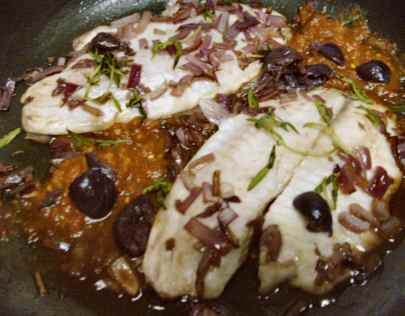 """tilapia fillets Veracruz-style, with smoky salsa, onions, garlic, alfonso olives, red wine and fresh za'atar or """"wild thyme"""""""