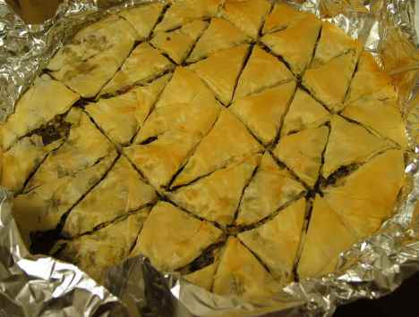 Artichoke and olive spanakopita tastes authentic even though it's completely nondairy. The party round is pretty quick to put together, too.